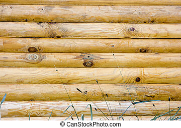 wooden logs - Photo of a wall of the house made of wooden...