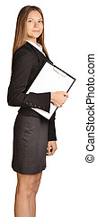 Business woman standing sideways and holding in hand...