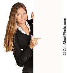 Business girl shows forefinger hand on the blank banner. -...