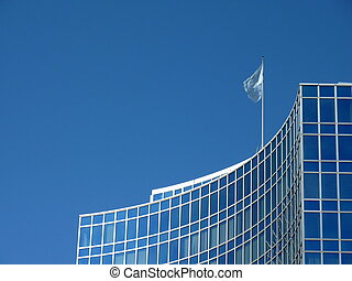 Modern building with United Nations flag