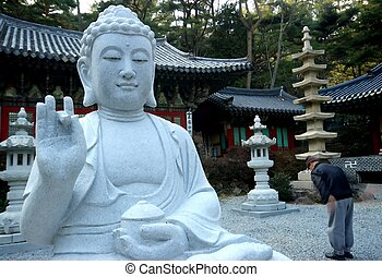 Bhuddist Statue and Temple - A Buddhist statue in the lotus...