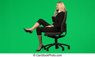 Businesswoman sitting on a chair on phone