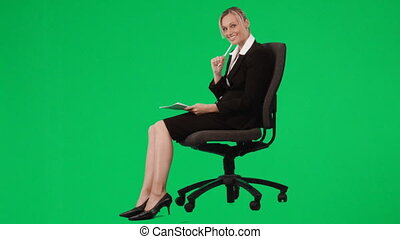 Young businesswoman in a swivel chair