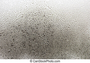 Misted glass - Misted window glass in drops of water as a...