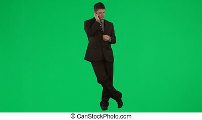 Businessman on mobile phone against green screen footage