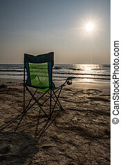 silouette beach Chairs at Sunset, Vacation Sunset Concept