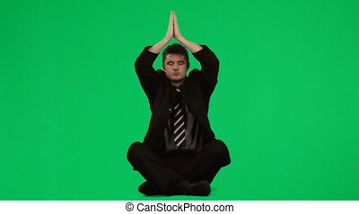 Businessman practicing yoga