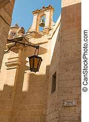 Ancient Mdina - Lantern in ancient narrow street of Mdina,...