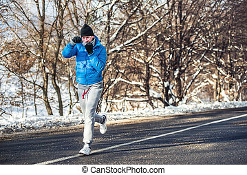 Professional boxer and athlete working out outdoor on snow...