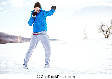 box training outdoor in snow, fitness concept, running and...