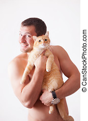 Man holding a cat on his hands