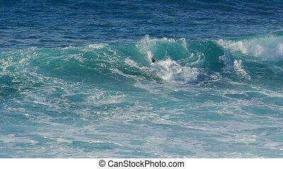 Waves Crashing on Stone Beach, slow motion