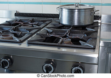 pot over the stove of industrial kitchen in stainless steel