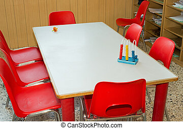 table with red chairs of a school class for children - table...