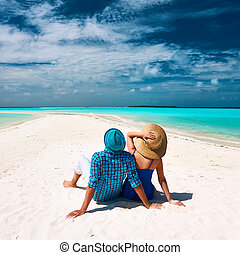 Couple in blue on a beach at Maldives - Couple in blue on a...