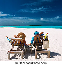 Couple relax on a beach at Maldives - Couple relax on a...