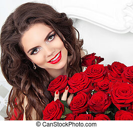 Beauty model girl with makeup, long hair and beautiful red...