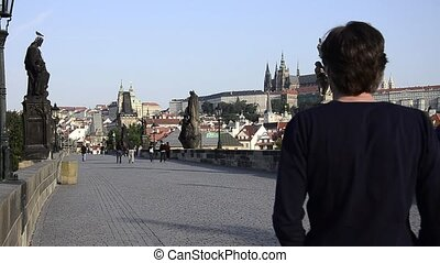 prague cityscape - prague, walking on charles bridge,...