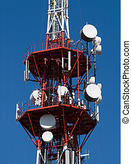 Modern communication antennas - Red and white TV tower with...