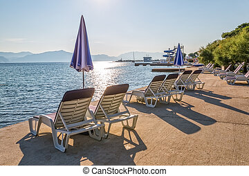 Beach in Supetar on island Brac - Deck chairs and parasols...