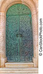 Grave door - The bronze doors of the old mausoleum with a...