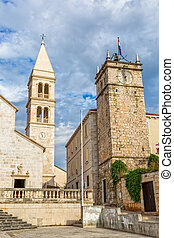 Supetar tower - The old church and the clock tower in...