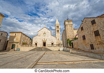 Supetar church - The old church and the clock tower in...
