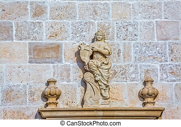 Stone sculpture on the wall of church in Supetar, Brac...
