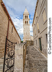 Supetar church tower - The old church and the clock tower in...