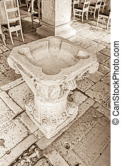 Supetar church baptistery - Old stone baptistery in the...