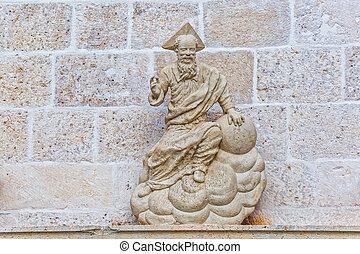 Old stone sculpture on the wall of church in Supetar, Brac...