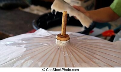 paper umbrella making in Asia - paper umbrella making in...