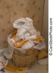 Sanitary - A wicker trash can overflowing with discarded...