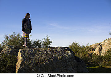 Woman standing on a rocky mountain - Woman standing on top...