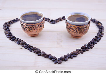 Heart made out of raw grains of coffee