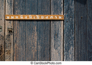 Old wood wall texture with Thai word One corner at Chiang...