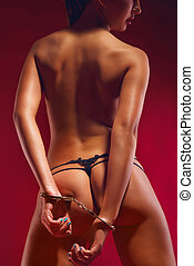 naked brunette on the red background