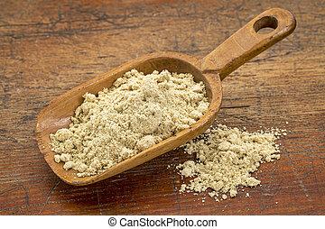 scoop of rice bran - a rustic scoop of rice bran against...