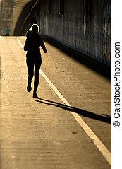 Single Female Jogger In Backlight