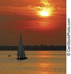 Yacht sailing at sunset - Orange sunset with sailing yachts...