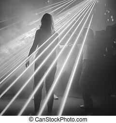 woman on dance floor - rear view of woman on dance floor in...