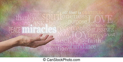 Miracles Happen - Woman's hand facing palm up with the word...
