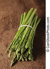 fresh asparagus spears - asparagus in bunch on wooden...