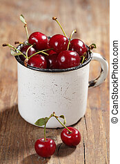 Sour cherry in the vintage rustic mug