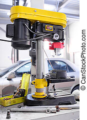 drilling machine in the service station