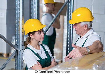Storage workers in warehouse - Storage workers during their...