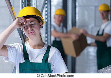 Tired female plant worker - Horizontal view of tired female...