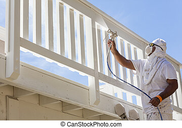 House Painter Spray Painting A Deck of A Home - House...