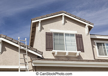 Ladder Leaning Up Against A Freshly Painted Home -...