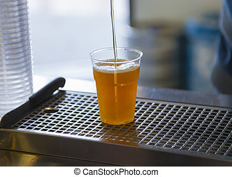 Drawing beer in a plastic cup - Drawing craft blonde beer in...